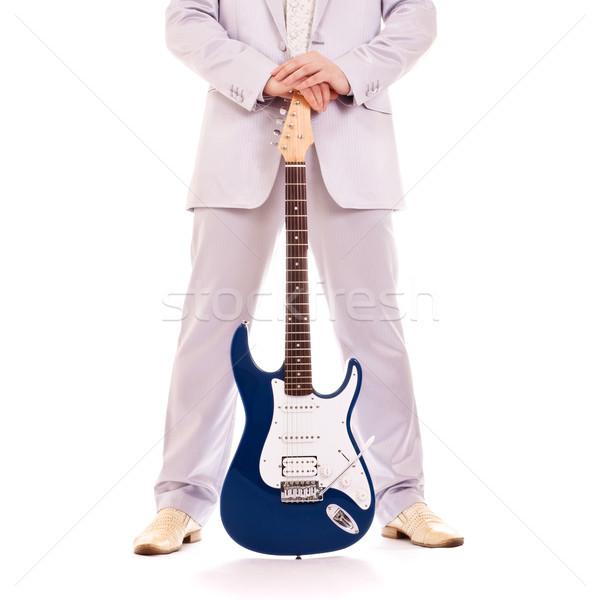 man standing with electro guitar Stock photo © PetrMalyshev
