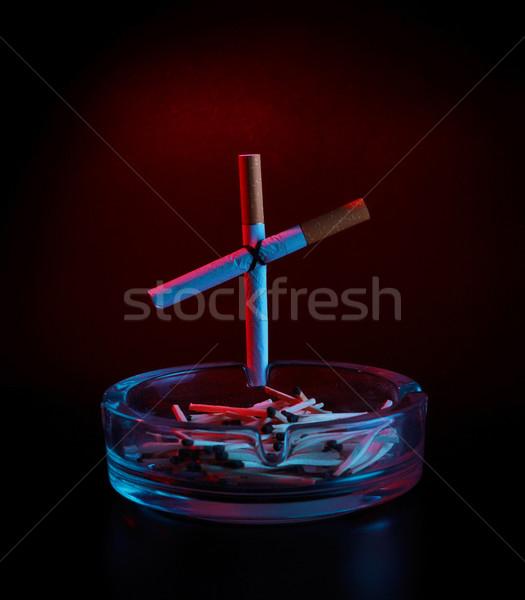 Sigara çapraz küllük karanlık kırmızı siyah Stok fotoğraf © PetrMalyshev
