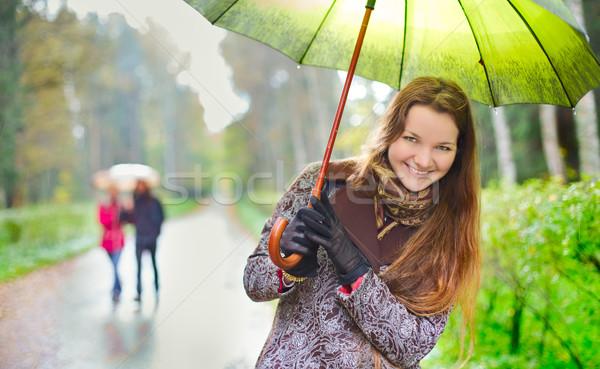 Kız yağmur gülme yürüyüş çift yağış miktarı Stok fotoğraf © PetrMalyshev