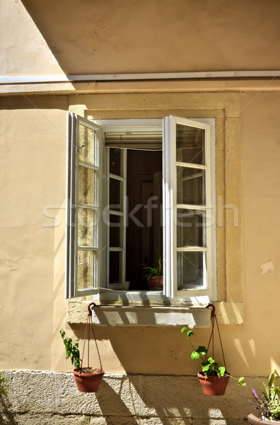 Stock photo: opened window with flowerpots