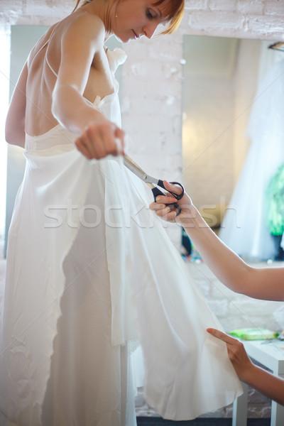 Menyasszony műhely gyönyörű nő fehér esküvői ruha varr Stock fotó © PetrMalyshev