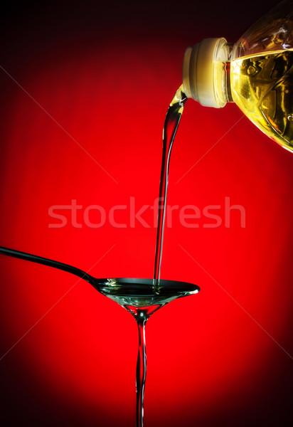 pouring oil on spoon Stock photo © PetrMalyshev