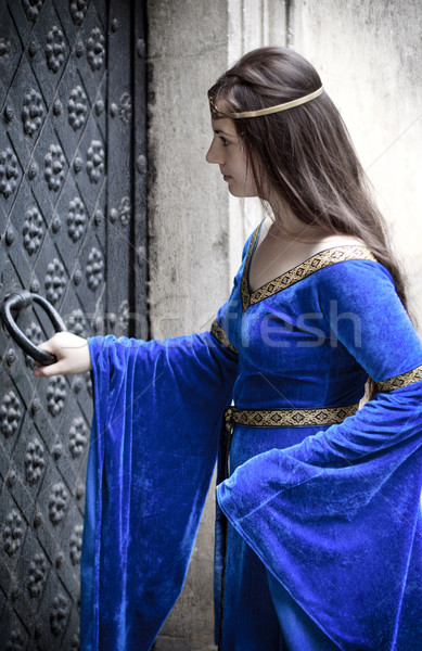 medieval girl opening door Stock photo © PetrMalyshev