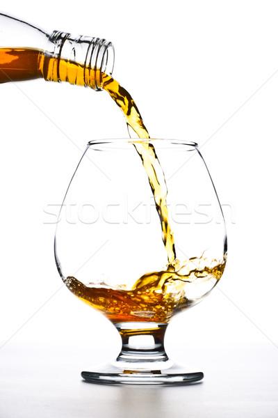 Cognac verre blanche fête Photo stock © PetrMalyshev