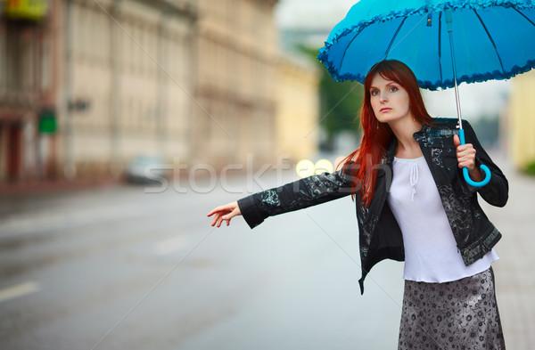 Lányok vörös hajú nő esernyő esős nap autó Stock fotó © PetrMalyshev