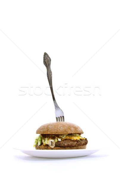 Stock photo: fork stuck in a fat sandwich