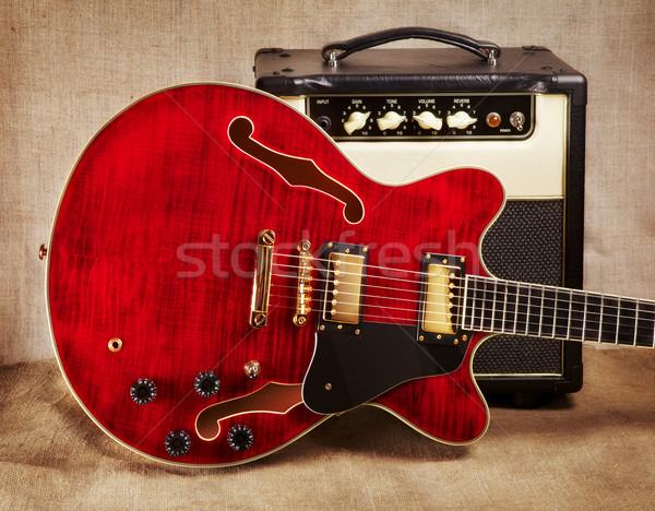 Gitár piros elektromos gitár barna vászon háttér Stock fotó © PetrMalyshev