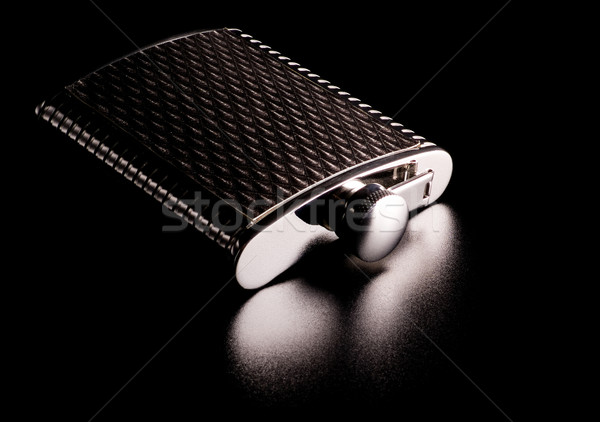alcohol grooved flask isolated on black Stock photo © PetrMalyshev