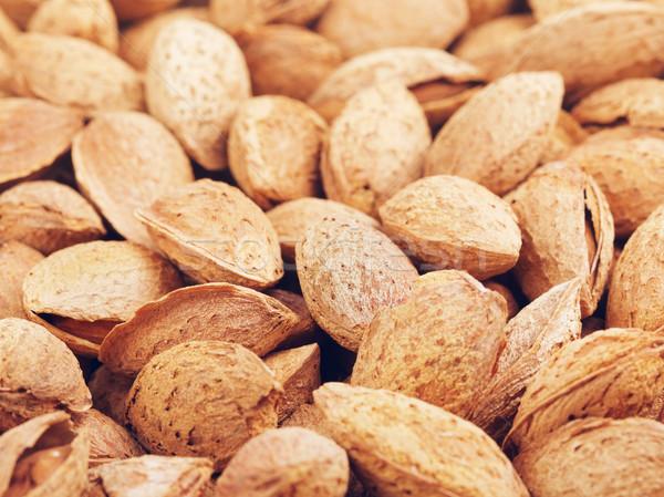 Unpeeled Almonds Nuts Background Stock photo © PetrMalyshev