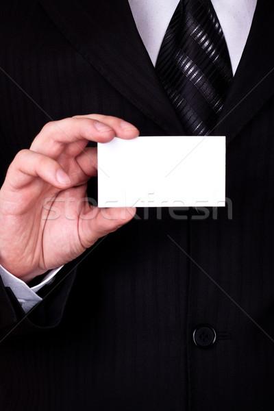 Empresario mostrar tarjeta en blanco primer plano hombre espacio Foto stock © PetrMalyshev