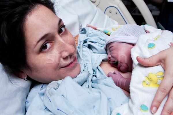 Feliz madre recién nacido bebé nacimiento Foto stock © phakimata