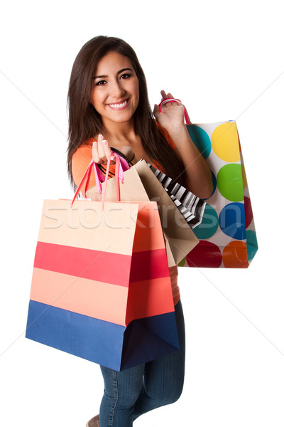 Happy young woman on shopping spree Stock photo © phakimata