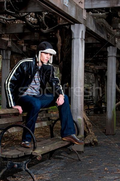 Hnadsome man on bench Stock photo © phakimata