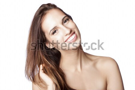 Happy woman touching hair Stock photo © phakimata