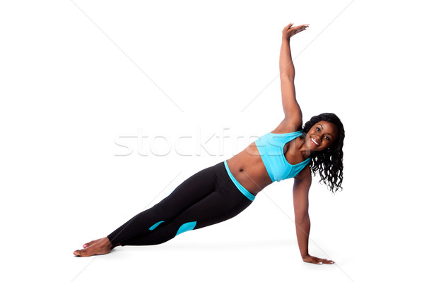 Szczęśliwy pilates jogi wykonywania piękna kobieta piętrze Zdjęcia stock © phakimata