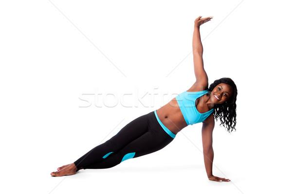 Feliz pilates ioga exercer bela mulher piso Foto stock © phakimata