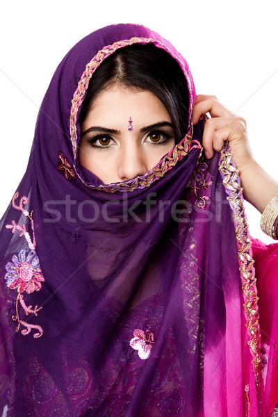Gyönyörű indiai nő színes ruha tart Stock fotó © phakimata