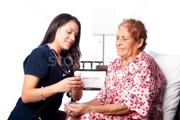 Senior paziente prescrizione spiegazione infermiera Foto d'archivio © phakimata