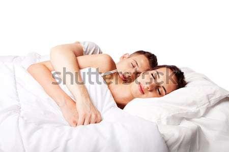Couple heureux lit heureusement Photo stock © phakimata