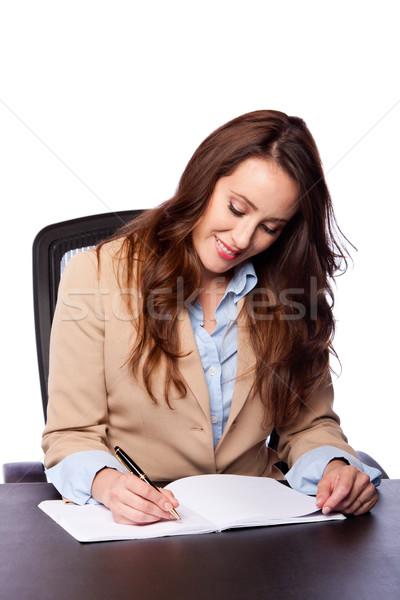 Corporate business woman writing Stock photo © phakimata