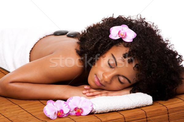 Beauty health day spa - hot stone massage Stock photo © phakimata