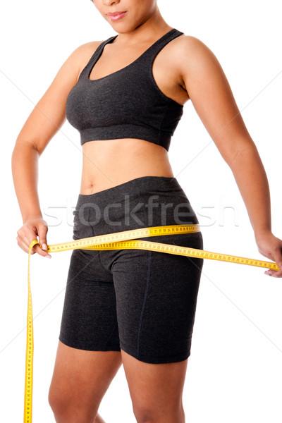 Woman measuring size of thigh Stock photo © phakimata
