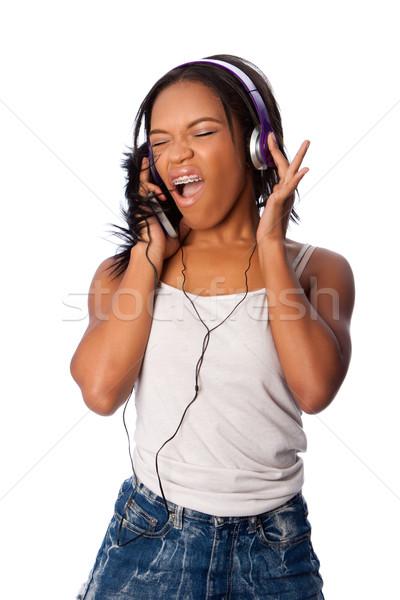 Chanter écouter de la musique belle adolescent heureusement blanche Photo stock © phakimata