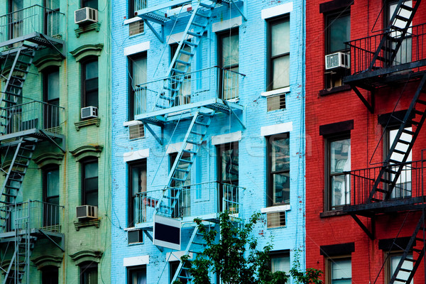 Colorful apartment buildings with fire escapes Stock photo © phakimata