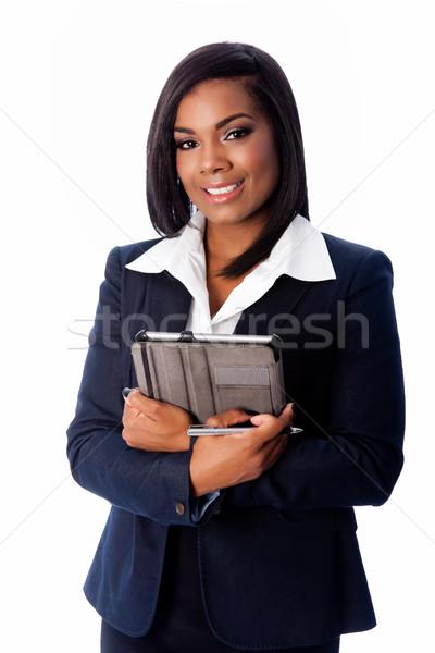 Souriant réussi femme d'affaires permanent comprimé heureux Photo stock © phakimata