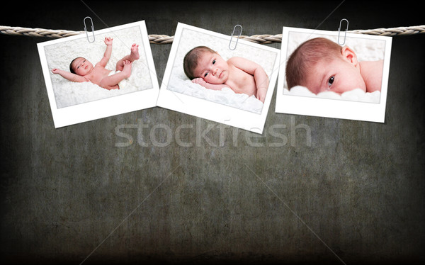 Cute baby photos hanging on rope Stock photo © phakimata