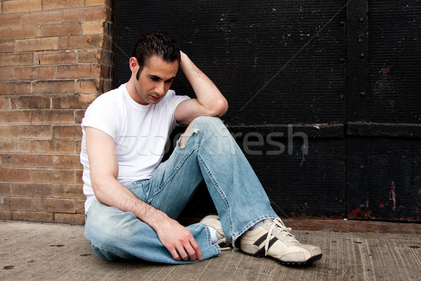 Depressed man Stock photo © phakimata
