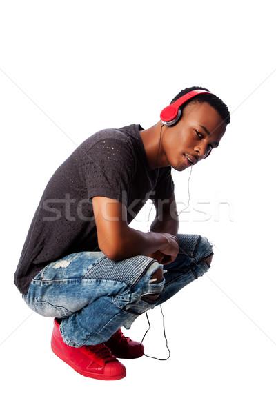 Handsome teenager listening to music Stock photo © phakimata