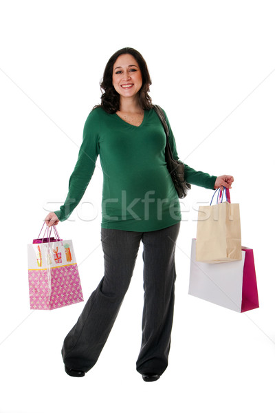 Happy woman with shopping bags Stock photo © phakimata