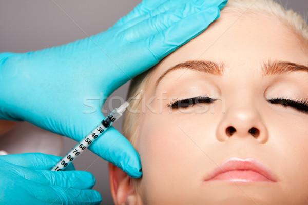 Cosmétiques plastique chirurgien visage belle jeune femme Photo stock © phakimata