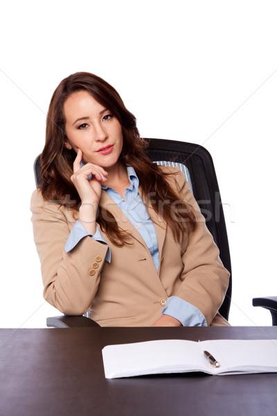 Corporate business woman at desk Stock photo © phakimata