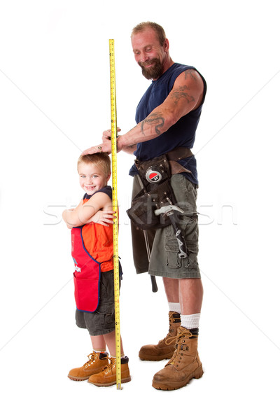 Dad measuring height of son Stock photo © phakimata