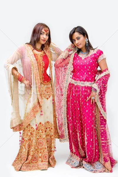 Menyasszonyok kettő gyönyörű színes ruhák izolált Stock fotó © phakimata