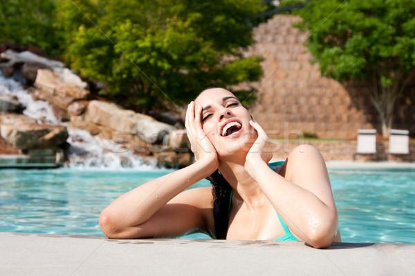 Woman enjoying water Stock photo © phakimata