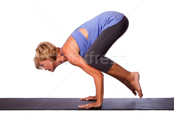 Yoga handstand by beautiful woman Stock photo © phakimata