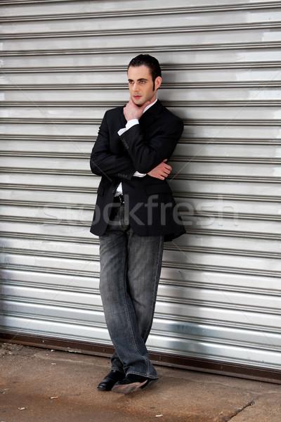 Homme d'affaires permanent élégant argent Photo stock © phakimata