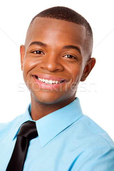 Handsome happy young business man Stock photo © phakimata