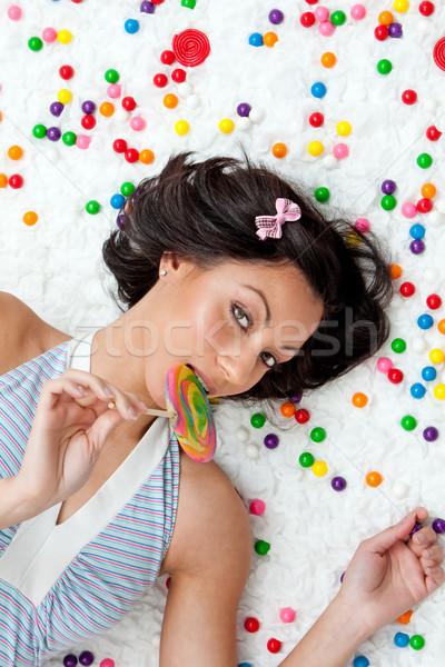 Lollipop ragazza giovani donna nube Foto d'archivio © phakimata