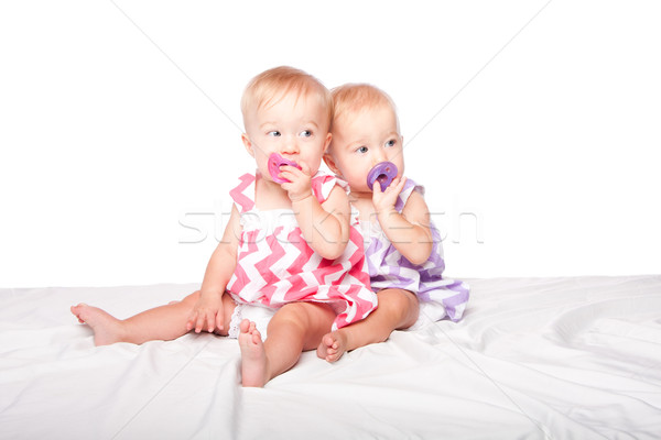 Pacifier twins Stock photo © phakimata
