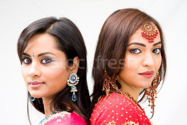 Gyönyörű menyasszonyok kettő színes ruhák izolált Stock fotó © phakimata