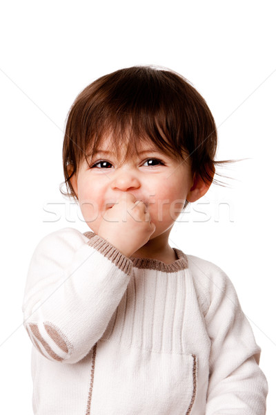 Cute mischievous baby toddler face Stock photo © phakimata