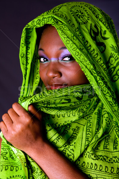 Shy African woman with scarf Stock photo © phakimata