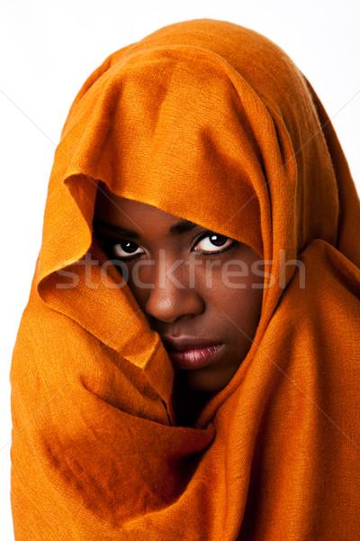 Stock photo: Mysterious female face in ocher head wrap