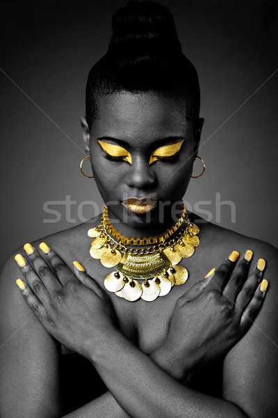 African tribal in gold Stock photo © phakimata