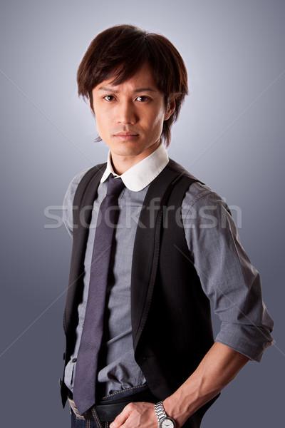 ázsiai üzletember tolakodó sikeres lezser visel Stock fotó © phakimata