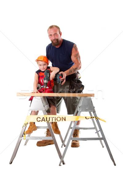Father teaching son drilling Stock photo © phakimata
